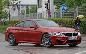 facelifted bmw m4 spied testing alongside aggressive special