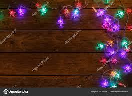 christmas lights border on wood background u2014 stock photo milkos