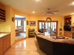 country living room with hardwood floors sunken living room in country living room with built in bookshelf sunken living room ceiling fan