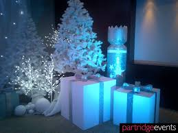 white trees and gift box props for a narnia themed christmas