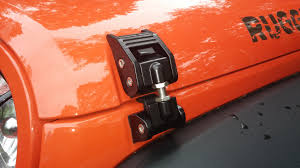 orange jeep cj how to eliminate jeep wrangler hood fluttering
