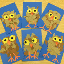 torn paper owlets we began by drawing the owl step by step and