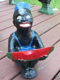 black watermelon boy statue lawn jockey cousin