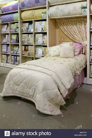 duvet cover and bed linen on display in store stock photo royalty