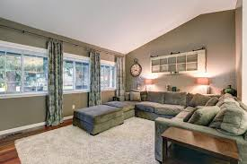 vaulted ceiling family room with taupe walls paint color stock