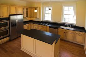 granite countertop nutmeg kitchen cabinets subway slate and