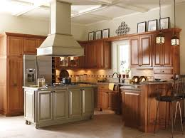 blue kitchen island with oak cabinets schrock uses brinkman oak doors in finish and maple