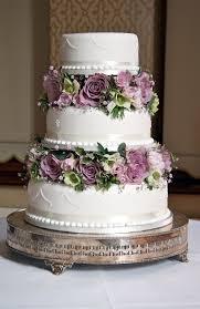wedding cake flowers wedding cakes simple wedding cake flowers between tiers to suit