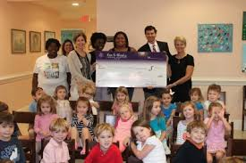 funeral director school fox weeks presents grant to the children s school at st s