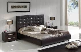 dark brown leather bed with tufted headboard and padded frame