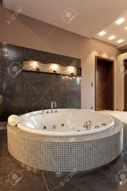 Small Elegant Bathrooms An Exclusive Round Bath With Small Tiles In An Elegant Bathroom