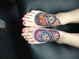 these are my feet daruma doll on right foot matryoshka dolls