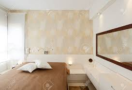 modern luxury bedroom with wallpaper hotel room stock photo