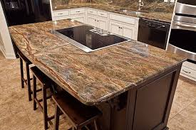 granite kitchen islands flat top with seating area and gentle curve to up the