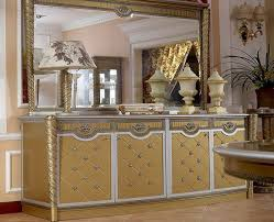 cream gold and silver sideboard with mirror image pictures