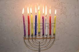 chanukah days colorful chanukah candles lit in the menorah colorful hanukkah