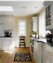 white washed cabinets kitchen traditional with breakfast bar