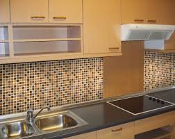 minimalist kitchen with brown glass tile backsplash stainless