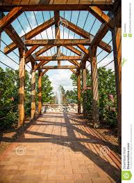 brick walkway through rose arbor toward fountain stock images