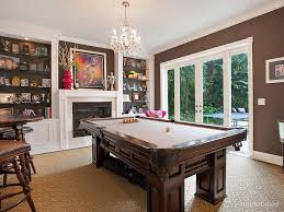 traditional game room with high ceiling crown molding chandelier