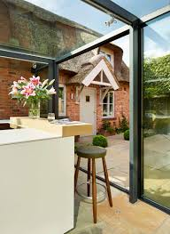 Glass Box House This Thatched Cottage Got A Glass Box Extension For The Kitchen