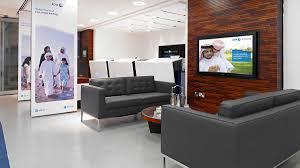 abu dhabi islamic bank identity and branch design uae