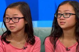identical twin sisters reunite after being adopted