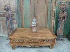 bali style coffee table i don t like the color but love the wood and its intricate detail