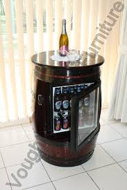 wine barrel table with a built in glass door bar fridge built from