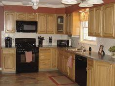 Kitchen Colors With Oak Cabinets Pictures by Oak Kitchen Cabinets With Granite Countertops And Black Appliances