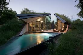 homes built into hillside ecology and modernism a half buried house with walls of glass