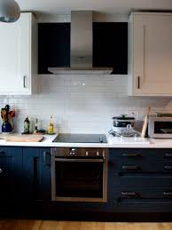 inky dark greyish blue white charcoal kitchen white subway tiles