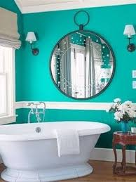 paint colors for bathrooms with blue color and round mirror and
