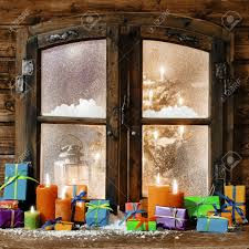 bow window images stock pictures royalty free bow window photos bow window colorful christmas gifts and glowing multicolored candles on a windowsill of a rustic