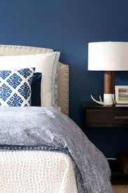 8 top interior designers who were self taught dark blue bedrooms