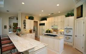 White Cabinets Granite Countertops by White Kitchen Cabinets With Wood Color Granite Countertops For