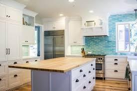 white kitchen cabinets with blue tiles white kitchen with bold blue backsplash kashas design build