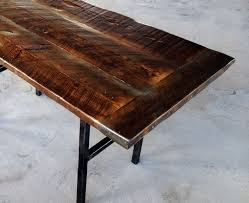 hand crafted reclaimed wood kitchen table with steel legs and iron