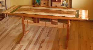 custom made trestle dining room table in koa and spanish cedar by