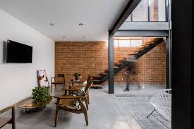 exposed brick walls steal the show in this modern industrial home