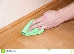 Skirting For Laminate Flooring Close Up Of Hand Cleaning The Wooden Oak Parquet Floor And