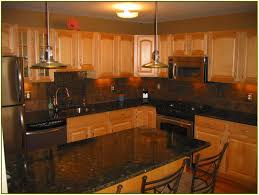granite countertop stained glass for cabinets brown sink franke