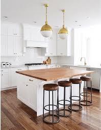 white kitchen island with butcher block transitional kitchen