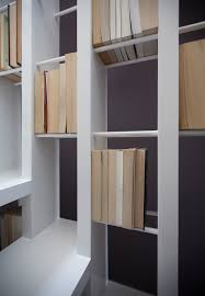 a new staircase does double duty as a bookcase u2013 moco loco