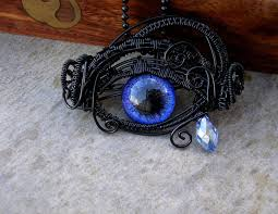 violet teardrop eye pendant glow in the by ladypirotessa on