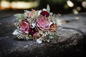 succulent bouquet wedding flower ideas for outdoor weddings