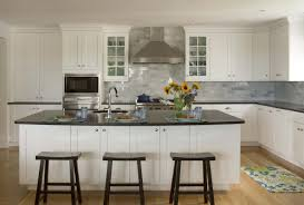 furniture white shaker cabinets with limestone backsplash and