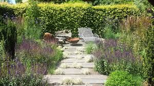 oak sleeper deck fire bowl and a prairie planting to attract bees