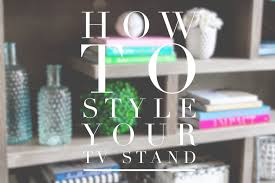 console table under tv how to style your tv stand or console table pretty in the pines