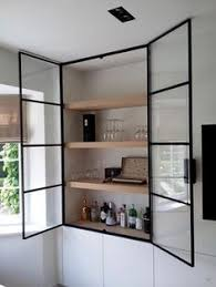 black glass front cabinet with white interior great way to